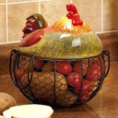 Farm Friend Wire Rooster Basket decorates your kitchen with a friendly, country-inspired look. Useful basket features a fancy topper that's shaped like the farm animal. It makes a wonderful addition to your countertop whether you display it on its ow Rooster Kitchen Decor, Rooster Decor, Chicken Kitchen Decor, Rooster Art, Primitive Kitchen, Kitchen Baskets, Wire Baskets, French Country Kitchens, French Country Decorating
