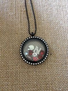 Nebraska Huskers Locket!  To order go to mariesdesigns.origamiowl.com or contact me :) https://www.facebook.com/mariesdesigns