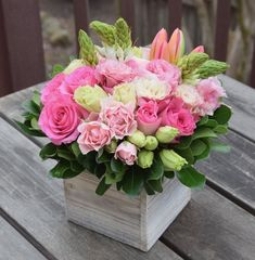 Floral gift box handcrafted by Fleurelity. Flower arrangement with pink and green blooms.