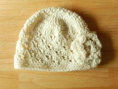 Make the Crazy-Darling One Skein Crochet Hat. Featuring a lovely shell stitch design and pretty flower motif, this free crochet hat pattern for women is perfect for any lovely lady in your life. One Skein Crochet, Crochet Flower Hat, Crochet Cap, Crochet Baby Hats, Crochet Beanie, Crochet For Kids, Free Crochet, Crocheted Hats, Crochet Stitch