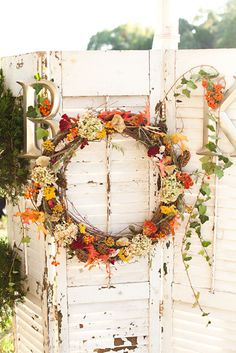 A fall wreath can give a nice rustic accent to an autumn wedding. This wreath on distressed shutters has a charming appeal. It would fit right in with barn wedding decorations. Wedding Wreaths, Fall Wedding Decorations, Wedding Ideas, Orange Wedding Flowers, Fall Flowers, Pink Flowers, Wedding Doors, Flower Installation, Autumn Bride