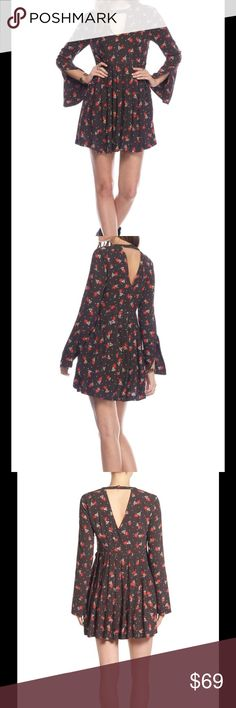 """BNWT Free People - Tegan Printed Mini Dress New with tag Free People Tegan Printed Mini Dress  PRODUCT DETAILS Fits true to size, order your normal size Round neck, long sleeves, slit cuffs Décolletage cutout, pintucked bodice front Concealed zip side closure, pleated skirt Two side slit pockets, button closure at nape Upper-back cutout, allover floral print Approx. 23.5"""" from back of neck to hem, based on a size 4  Reasonable offers always welcome but not interested to trade Free People…"""