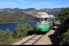 A saisonal Touristic Train passing the Lake Flumendosa, Sardinia.