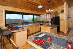 An Absolute High -- The main level has a fully equipped country kitchen with microwave, dishwasher, freestanding cooking island and huge windows to view the spectacular mountains while cooking or enjoying your meal.