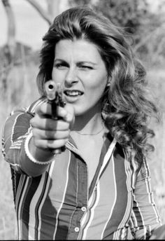 Yolanda Kloppers, Miss South Africa aims pistol while visiting the troops of the Rhodesian