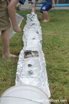 Tin foil river, hose at the top - simple way to stay cool!