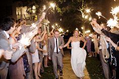 Wedding Sparklers Photo: happy-bride-smiling-sparklers.jpg