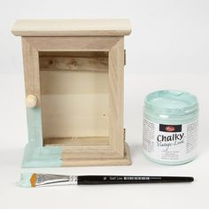 A Wooden Key Cabinet Painted With Chalky Vintage Look Paint