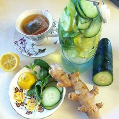 FLAT BELLY INFUSED WATER WITH CUCUMBER, GINGER, MINT, AND LEMON. 2 liters water (about 8 ½ cups) 1 teaspoon freshly grated ginger 1 medium cucumber, peeled and thinly sliced 1 medium lemon, thinly sliced 12 small spearmint leaves.  Combine all ingredients in a large pitcher and let flavors blend overnight.