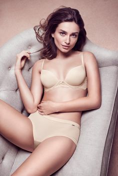 Andreea wears a nude colored lingerie set