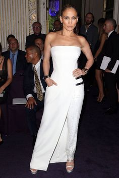 The superstar wore this white custom Atelier Versace jumpsuit to sit front row at the Versace Fall 2014 Couture show.    - ELLE.com