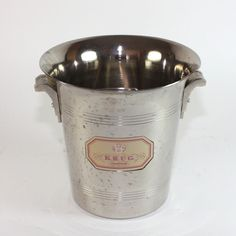 The bucket is made of brass and the inside is tin lined. With its beautiful grapes shaped zamac handles its a very rare piece. Krug Champagne, Champagne Buckets, Bucket Cooler, Cottage, Shopping, Cabin, Cottages