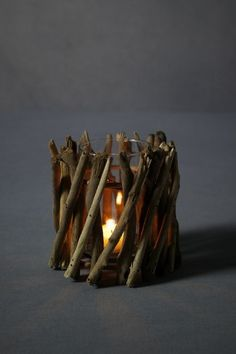 Glue sticks in a 'criss-cross' pattern to display flickers of light from the candle