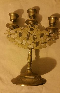 Check out this item in my Etsy shop https://www.etsy.com/listing/249746178/chinese-brass-candlebra