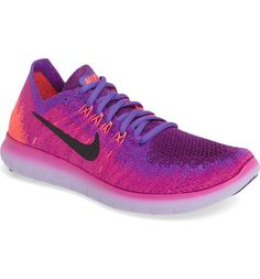 Swooning over these vibrant Nike Flyknit running shoes that are sure to stand out.