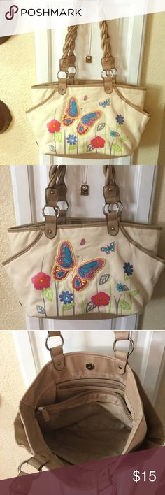 Beautiful butterfly purse In great condition. With beautiful butterfly and flowers designs in it. Fratelli Rossetti Bags Shoulder Bags
