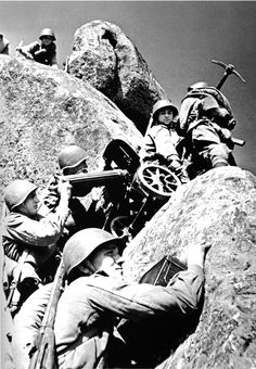 A Russian maxim machinegun crew changes its position in the Carpathian Mountains, August 1944.