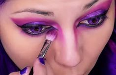 The Cheshire Cat isn't like other famous cartoon cats: he's brilliantly purple and hot pink, ever smiling and entirely unnatural. However, he makes for a perfect Halloween costume, with his bright, neon appearance and mysterious nature. With this step-by-step makeup tutorial from YouTuber Charisma Star, you can turn yourself into the Cheshire Cat himself—no sewing, sweating, or item-hunting needed. Rather than slathering on body paint in shades of purple and pink, or sticking on clump...
