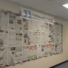 Recycled newspaper bulletin board with 'fifthbook' friends title. Kids fill out profile pages for us to post on the board.