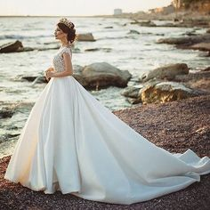 Like a siren in the sea. Perfectly elegant in @crystaldesign_official for her seaside wedding.