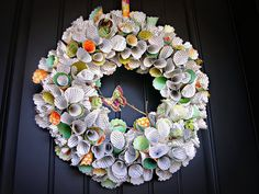 Laura, you are awesome! I love this wreath and I'm going do this project! See her tutorial.http://www.cornerhouseblog.com/2011/07/awesome-paper-cone-wreath-tutorial.html