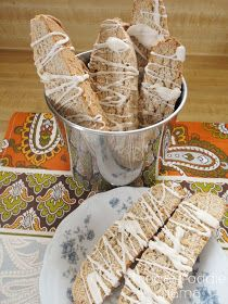 Coconut Chai Biscotti from Frugal Foodie Mama- a perfectly chai spiced biscotti with a hint of coconut drizzled in a cinnamon white chocolate