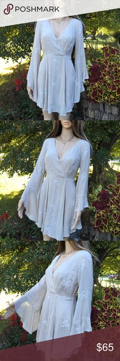 FREE PEOPLE BELL SLEEVE ROMPER NWT Free People beautiful cream color with white embroidered flowers, bell sleeve romper, side zipper available in black & white also🌺 Free People Pants Jumpsuits & Rompers