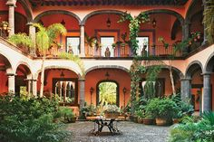 19th-century Mexican hacienda. It's a bit like a Moroccan riad in the layout of this but without the water feature and pretty tiles. It's a bit more open an rustic.