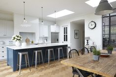 Industrial style crittal kitchen with herringbone floor