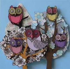 Whimsy owl art, made from hand cutting, folding and scoring paper.