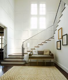 like the boxed pillows on the settee, open foyer, lovely staircase . Longmont - traditional - staircase - houston - Thompson Custom Homes Entry Stairs, Entry Hallway, Grand Staircase, Stairway Walls, White Hallway, Open Stairs, Benjamin Moore Cloud White, Wainscoting Stairs, Wainscoting Height
