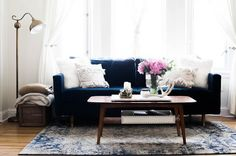 Spotted: the navy, velvet Remington sofa looking radiant in @mandaholstein's San Francisco studio tour. Click to see more pics of her beautiful apartment! *Photo: Amanda Holstein.