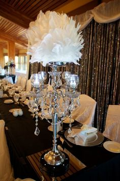 Vintage Feather Sphere Centerpiece - For Modern Brides: 25 Fabulous Wedding Centerpieces Without Flowers - EverAfterGuide