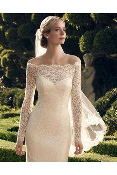 Robe de mariée dentelle manches longues épaule dégagé