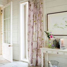 Add warmth to a drafty hallway by hanging a long curtain in front of the main door. To add extra colour, try lining the curtain with another colour, then when the sun shines through it will brings a warm tinge to the curtain