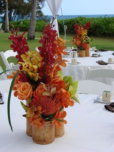 tropical reception wedding flowers, wedding decor, wedding flower centerpiece, wedding flower arrangement, add pic source on comment and we will update it. can create this beautiful wedding flower Arrangement Bamboo Centerpieces, Tropical Centerpieces, Tropical Flower Arrangements, Wedding Flower Arrangements, Wedding Table Centerpieces, Flower Centerpieces, Tropical Flowers, Wedding Flowers, Wedding Decorations