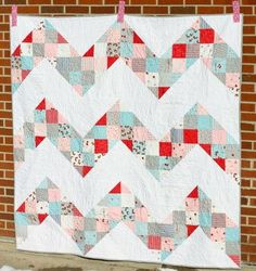 Whether the weather is warm or cold, the Exhilarating Chevron Quilt Pattern can always evoke delightful feelings of sunshine and a fresh spring breeze with its cheerful patchwork and lively colors.