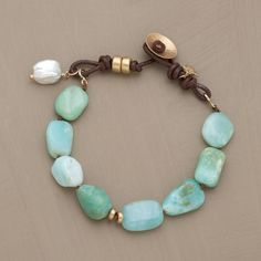 Naomi Herndon interprets Santa Fe summer skies: Peruvian opals for the beautiful blues, satin-finished 14kt gold for the sun, a cultured nugget pearl for the rare cloud...