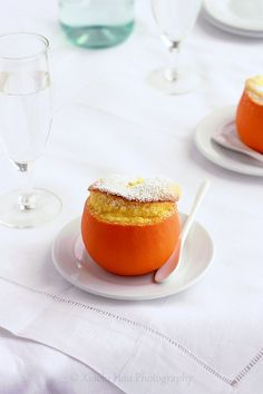orange grand marnier souffle. oranges, eggs, sugar, cornstarch, orange juice, milk, orange zest, grand marnier or defrosted orange-juice concentrate, salt, and powdered sugar. yum.