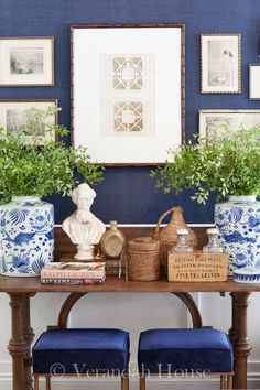 Love the art display on the bold blue wall color! Unique and beautiful Ottomans!