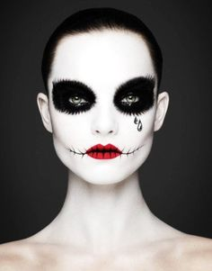 2015 spooky joker with tears face makeup for Halloween - stitch mouth, black eyes - 2015 Halloween makeup ideas by alisson_34