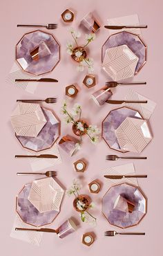 Elegant pale pink cocktail napkins inset with elegant gold stripes add a dash of style to your tabletop, dessert station, or bar cart. Colors: Pale pink, rose gold foil Cocktail napkins Made of paper Approx.