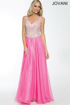 f570436356 Jovani 23548 is pretty in pink! This chiffon Jovani prom dress features a  modest