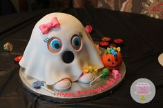 Super cute baby girl ghost birthday cake. So festive for Halloween!