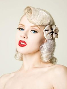 Platinum blonde color modernizes this retro look