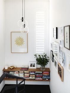 Entrance stairwell – collection of art, prints, photos and memorabilia on the wall including Patch NYC and Astier de Villatte ceramics, and ...