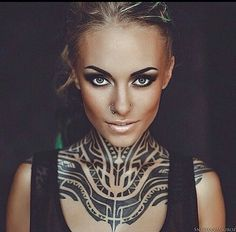 Tattoo Model/Collector teyasalat has an incredibly distinct tribal neck tattoo that we know is freehand but the tattoo artist in unknown. Please let us know if you know the artist behind this distinct contemporary tribal tattoo! Thanks!