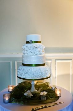 ..Not just a pretty cake.. Adorned with a sophisticated green hue, this beautiful cake was featured in the link below: http://thebowdonrooms.co.uk/our-wedding-was-a-magical-fairytale/