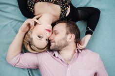 #engagement photoshoot couple lying on picnic blanket