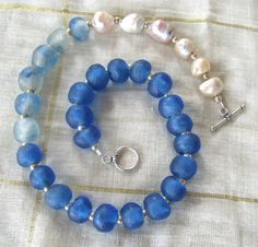 African recycled blue glass beads with Pearls by jeweledhorizons, $75.00